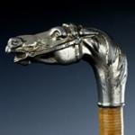 Bastone con manopola nichelata a forma di testa di cavallo con redini e morso tirati, Germania XIX secolo.